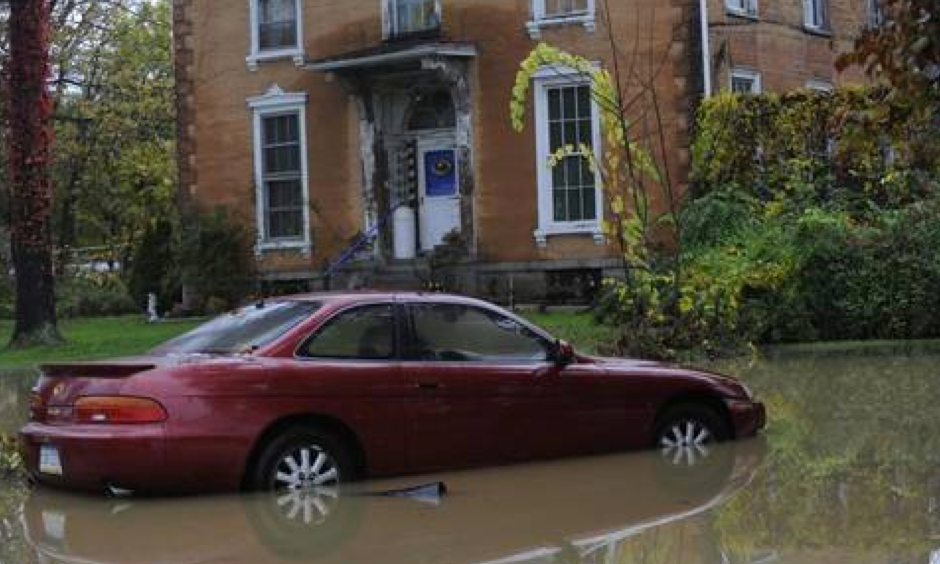 A car sits in flood water in Milesburg. Photo: John Boogert, Centre Dailiy