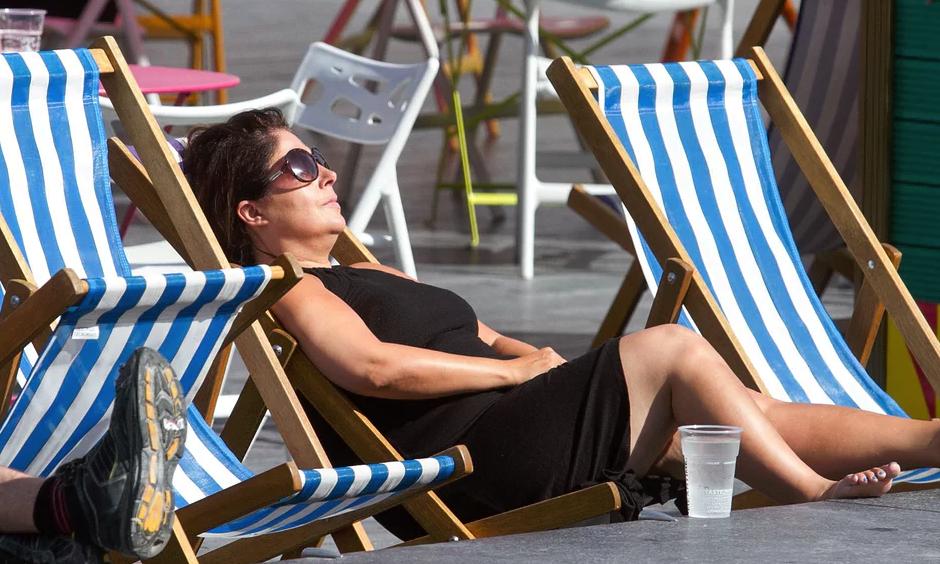 A woman sunbathes on a deckchair in central London. Photo: Amer Ghazzal, Rex, Shutterstock