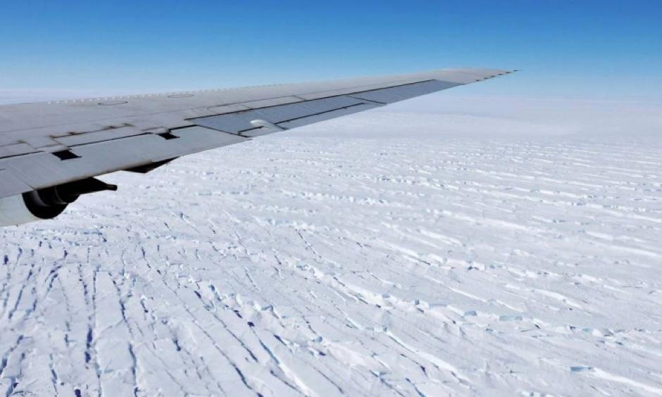 West Antarctica's massive Pine Island Glacier is seen out the window of NASA's DC-8 research aircraft as it flies at an altitude of 1,500 feet in October 2009. Pine Island Glacier is one of the fastest-retreating glaciers in Antarctica. Click image to enlarge. Photo: Jane Peterson, NASA