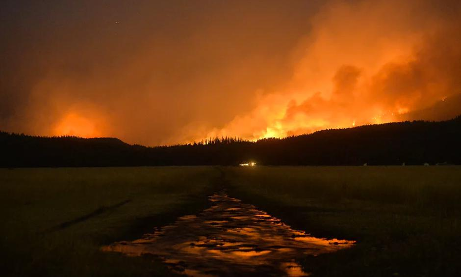 A wildfire burns in the Lolo national forest in Montana in August. The severe drought has served as ideal conditions for continued fires. Photo: Rion Sanders/AP