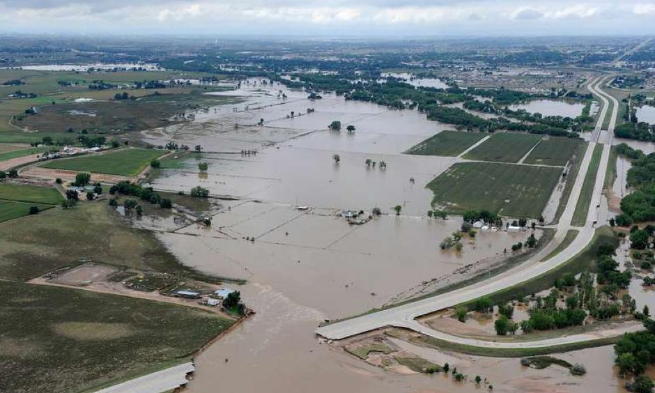 This picture was taken above Greeley, Colo. on Sept. 16, 2013. As a result of the flooding, the state lost approximately 500 miles of roadway and more than 30 bridges. Here, U.S. 34 in Greeley is breached by the South Platte River in flood stage. Photo: US Environmental Protection Agency
