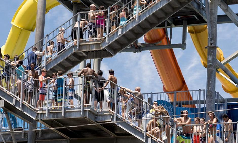 People looking to beat the heat ascend a water slide stairway at Knott's Soak City in Buena Park, Calif., on Friday, July 7, 2017. Los Angeles tied their record high for the date, 96°. Photo: Leonard Ortiz, The Orange County Register via AP