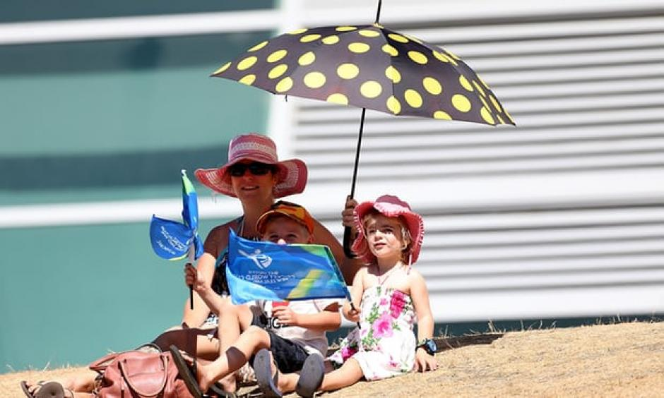 Supporters take shelter from the heat during the under-19 Cricket World Cup match between New Zealand and England in Queenstown. Credit: Dianne Manson-IDI, Getty Images