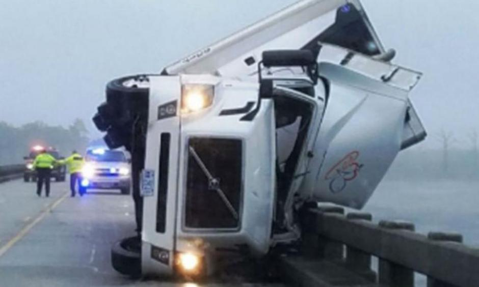 A man was killed Saturday after his tractor-trailer overturned because of high winds on the Lindsay C. Warren Bridge east of Columbia, North Carolina. Photo:  Tyrrell County Sheriff's Office