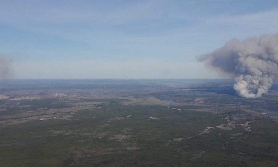 These two fires started at about the same time on May 1, 2016 near Fort McMurray, Alberta, Canada. Seen just after they started, on the left is the MMD-004 fire inside the city limits of Fort McMurray. The Horse River Fire, often referred to as the Fort McMurray Fire, is on the right. Alberta Forestry photo.
