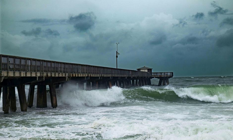 Waves pound a pier on Pompano Beach, Florida, spurred by Hurricane Matthew. The state is ill-prepared for rising seas, experts warn. Photo: Gaston de Cardenas, AFP Getty