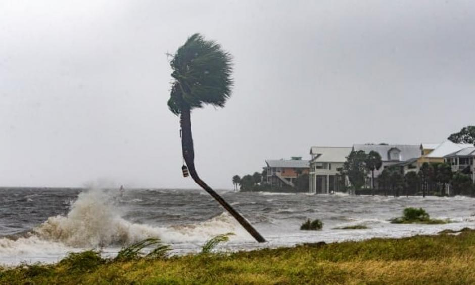 The storm surge and waves from Hurricane Michael are shown near beachfront homes on Wednesday in the Florida Panhandle community of Shell Point Beach. Photo: Mark Wallheiser, Getty Images