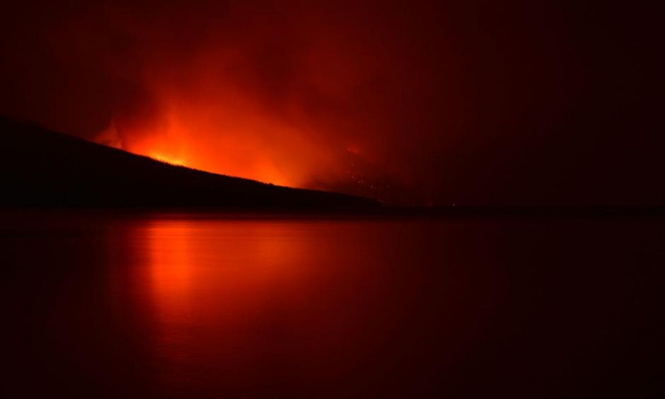 A night view of the Howe Ridge Fire on the shores of Lake McDonald. Photo: Glacier National Park