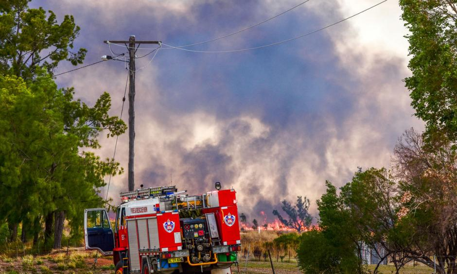 Emergency crews tackle a bushfire at Boggabri, one of dozens across NSW during the heatwave. Photo: Karen Hodge, AAP