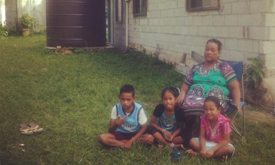 Rusina Rusin on April 16, 2015, with her grandchildren, including Keslynna Myo Sibok, right, at their home in the part of the Marshall Islands' Majuro Atoll that is most vulnerable to flooding.Photo: Renee Lewis, Al Jazeera
