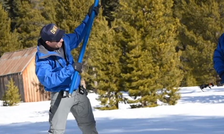 John King, a DWR water resource engineer who conducted the survey, discusses the snowpack in Phillips, California. Photo: Vincent Moleski