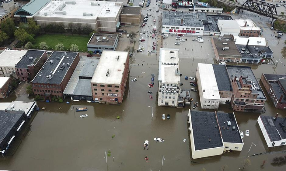 An aerial view of Davenport, Iowa, which remains flooded after a temporary levee broke. Credit: Facebook.com/QC DRONE, Newscom