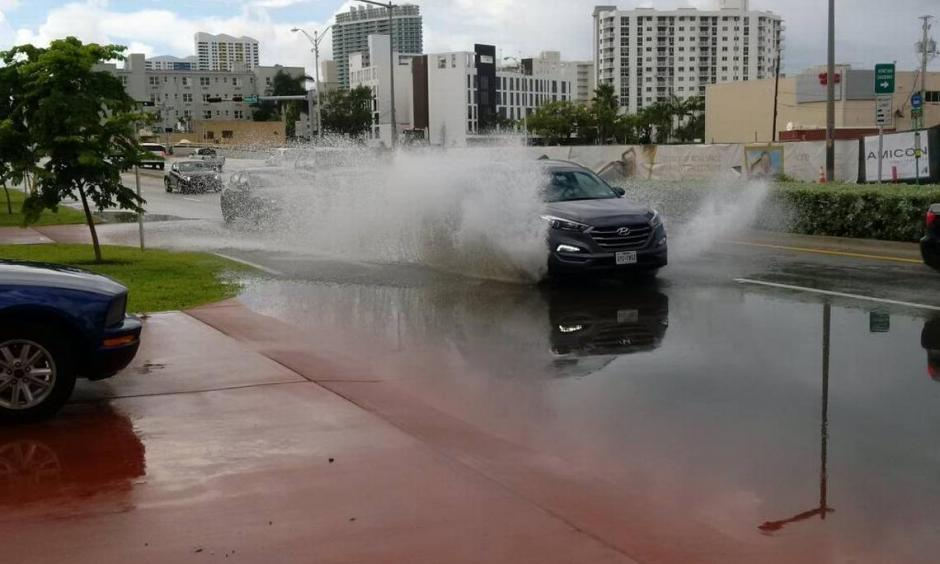 An SUV splashes down Miami Beach's Alton Road Sunday morning. Photo: David J. Neal
