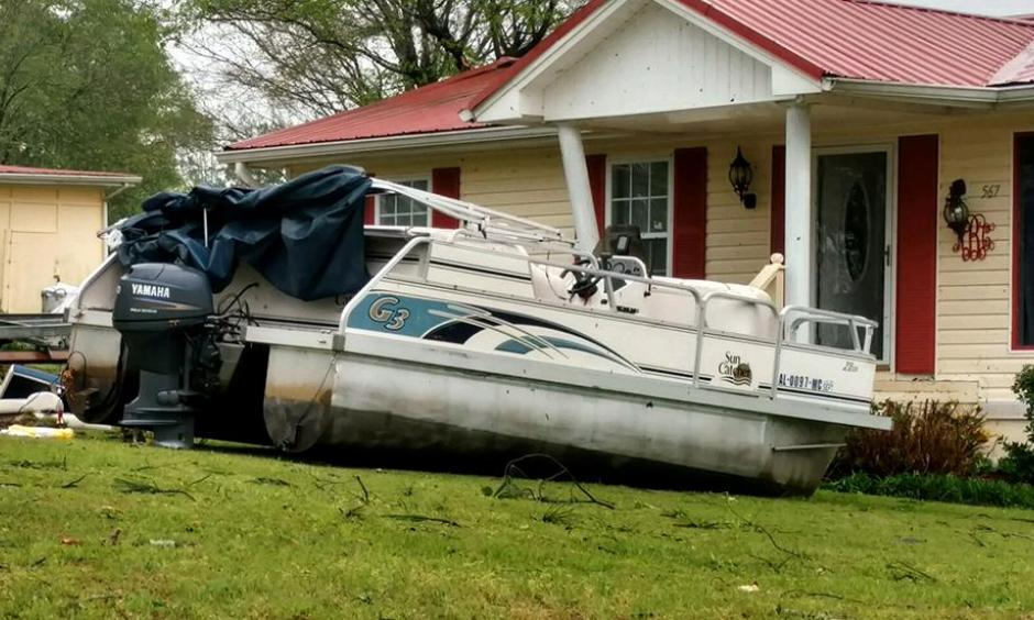 A boat sits in the front yard of a home in Henry County, Alabama, after a suspected tornado touched down in the area on April 5, 2017. Photo: Michele W. Forehand, Dothan Eagle via AP