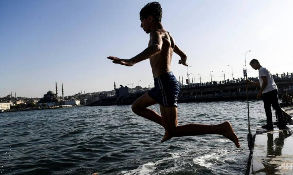 In Istanbul, many people took a dip in the Bosphorus to cool down. Photo: Bulent Kilic, AFP