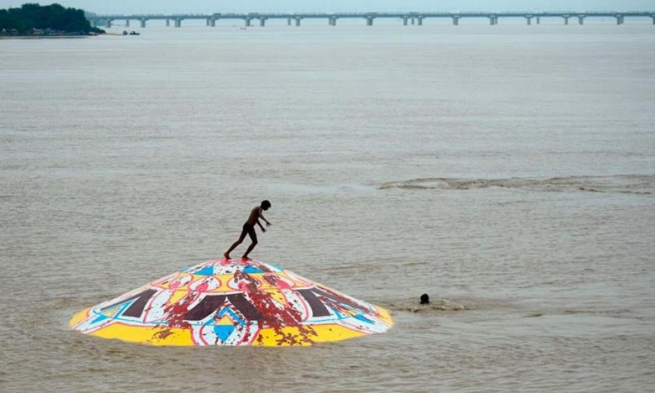 An Indian youth stands on the top of a submerged portion of Arail Ghat as he prepares to jump into the flooded Yamuna River in Allahabad, India on August 21, 2019. Monsoon flooding in India during late July and August killed at least 287 people, making it the deadliest weather-related disaster of the month. Photo: Sanjay Kanojia, AFP/Getty Images