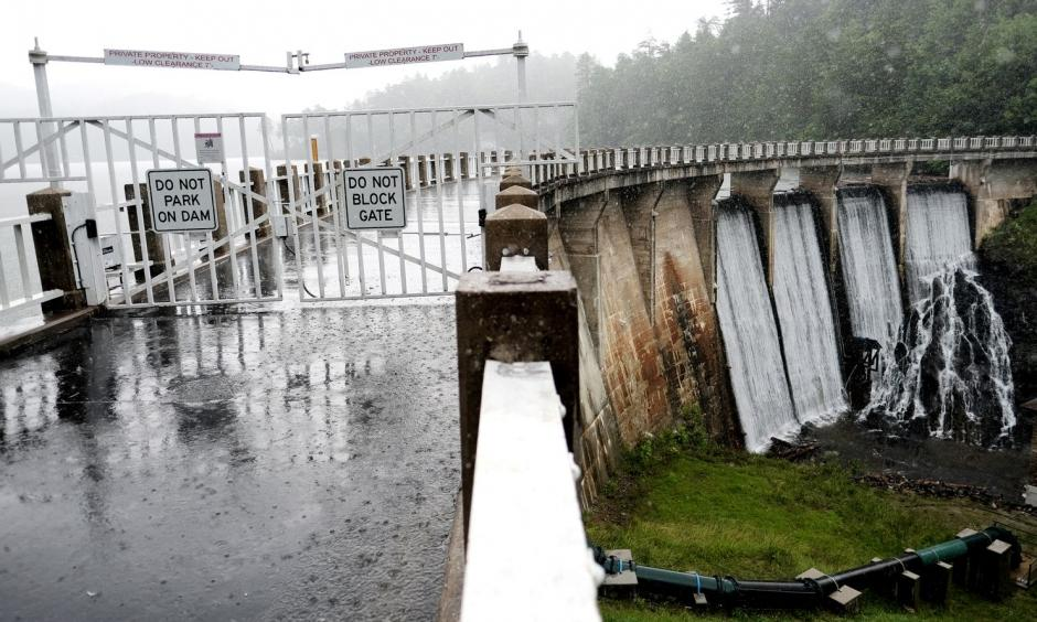 Rain falls at the Lake Tahoma Dam near Marion, N.C., on June 13. Excessive rain in the region recently led to mudslides and flooding, and many worried that the dam might be compromised, leading to evacuations. Photo: Bonnie Jo Mount, The Washington Post