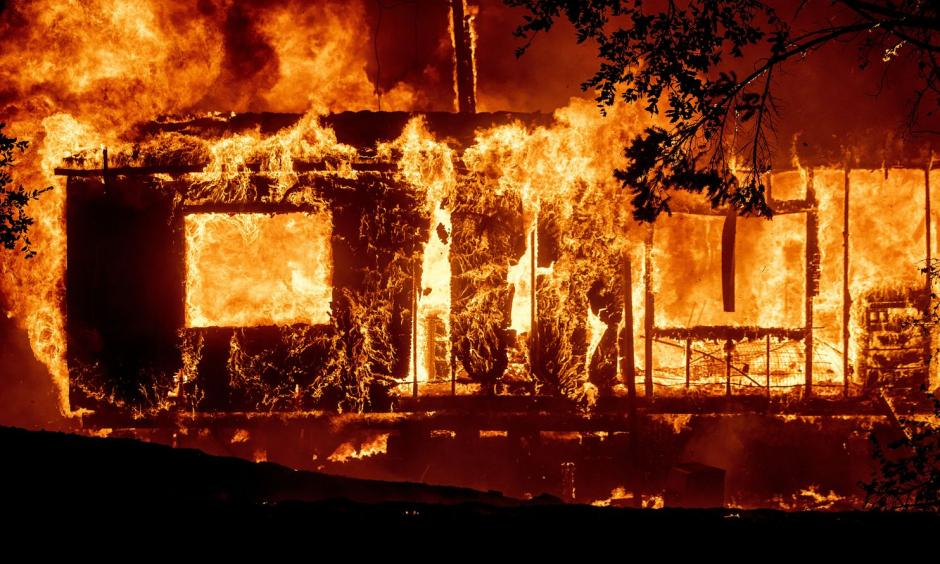 Flames consume a home as the Kincade Fire tears through the Jimtown community of Sonoma County, Calif. Credit: Noah Berger/AP