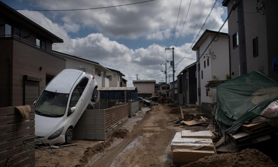 A street devastated by floods and landslides in Mabi, Okayama prefecture. Credit: Martin Bureau, AFP