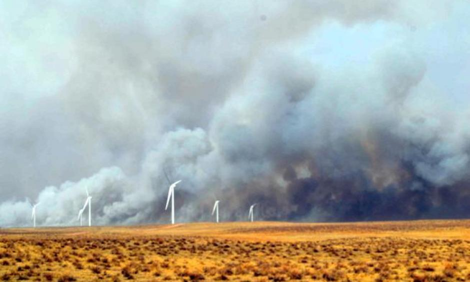 Smoke billows behind wind turbines north of Fleming Monday afternoon. A wildfire burned out of control from the Crook and Proctor area south and east into Phillips County, fueled by dry conditions and strong winds. Photo: Jeff Rice, Sterling Journal-Advocate