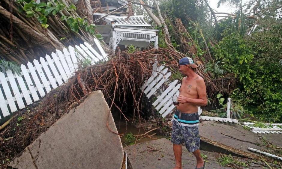 Robert Phillips looks at the former Key West house of poet and author Shel Silverstein, which was crushed by a falling tree as Hurricane Irma swept through, September 10, 2017. Photo: Charles Trainor, Jr.