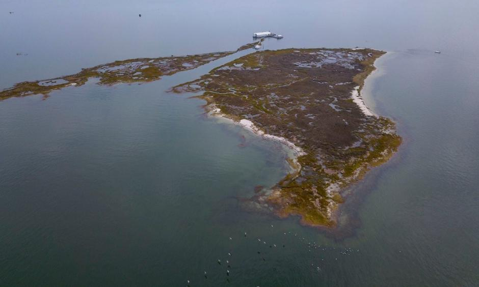 An aerial view of the lodge on Fox Island. The Chesapeake Bay Foundation's Fox Island Environmental Education Program will be closing for good because of rising sea levels and erosion. Credit: Ricky Carioti/The Washington Post