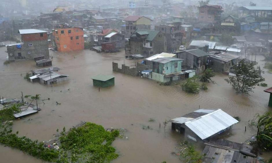 Houses, partially submerged in floods waters caused by heavy rains brought by Typhoon Koppu, are seen in City Camp Lagoon at Baguio city, north of Manila October 19, 2015. Typhoon Koppu swept across the northern Philippines killing at least nine people as trees, power lines and walls were toppled and flood waters spread far from riverbeds, but tens of thousands of people were evacuated in time. (REUTERS/Harley Palangchao)