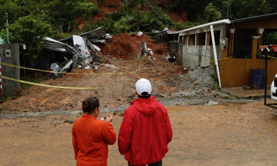 Panamanian civil defense workers view a mudslide that destroyed a home and killed the couple inside in Arraijan, on the outskirts of Panama City on Tuesday. Photo: Associated Press