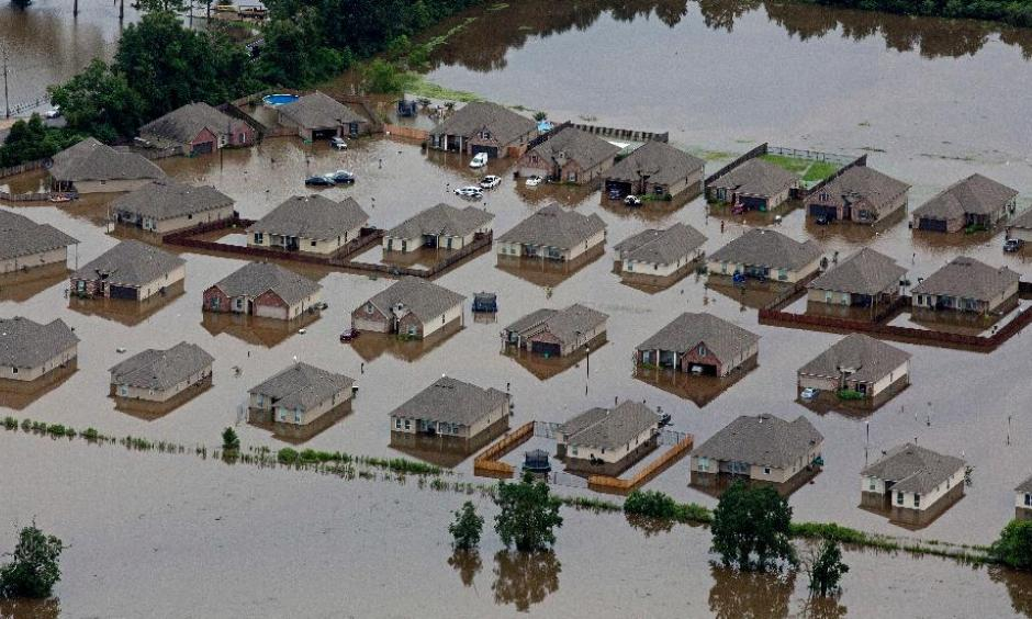 In this aerial photo over Hammond, La., flooded homes are seen off of LA-1064 after heavy rains inundated the region, Saturday, Aug. 13, 2016. Photo: Max Becherer, AP