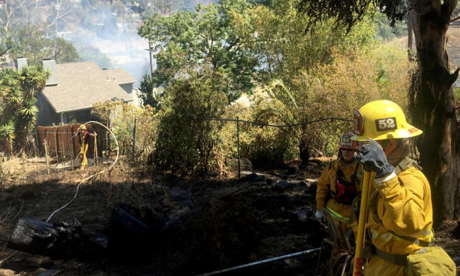 In Silver Lake, a fire at a home quickly spread to brush along the 2 Freeway, prompting firefighters to call for more resources and air support. The freeway was closed in both directions near its terminus in Echo Park. Photo: Dillon Deaton / Los Angeles Times