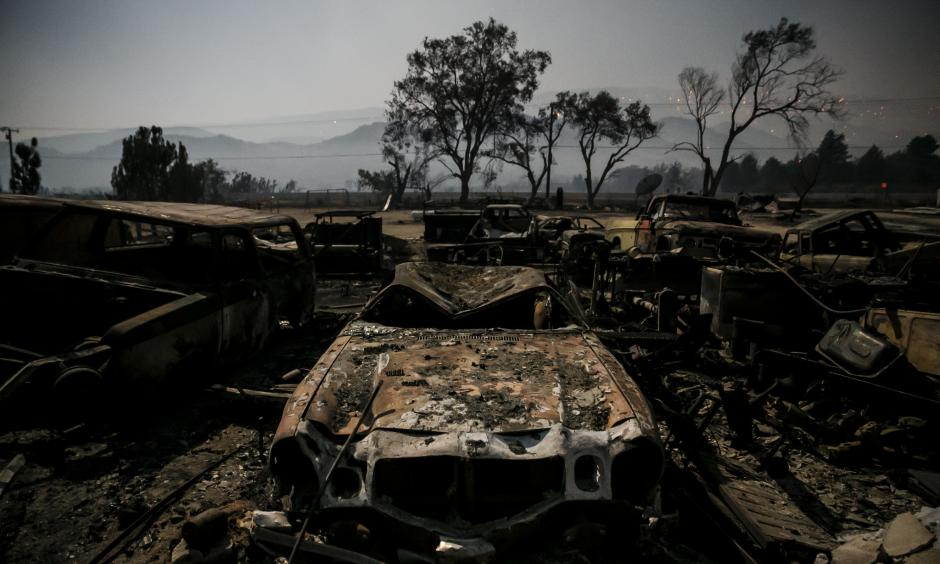 Burned vehicles glow in the light of the full moon on Highway 138 in Phelan as the Blue Cut fire burned in San Bernardino County. Photo: Marcus Yam / Los Angeles Times