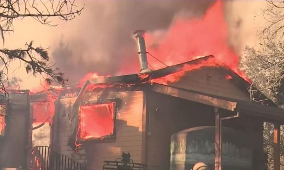 Over 1,100 firefighters are currently battling the Ponderosa Fire in Butte County that has destroyed ten homes. A suspect was arrested in connection with the fire Tuesday.