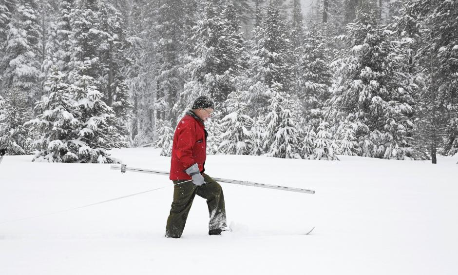 Frank Gehrke of the California Department of Water Resources surveys the snowpack at Phillips Station near Echo Summit, Calif. Photo: Rich Pedroncelli / Associated Press