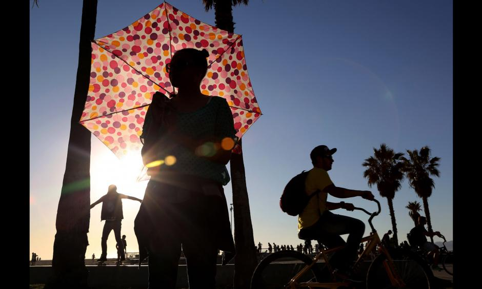 Ariel Rhone uses an umbrella for shade near the Venice boardwalk on Monday. Photo: Katie Falkenberg, Los Angeles Times