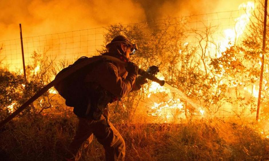 Firefighters attempt to control flames as they approach a vineyard in the Santa Cruz Mountains. Photo: Josh Edelson, AFP, Getty Images