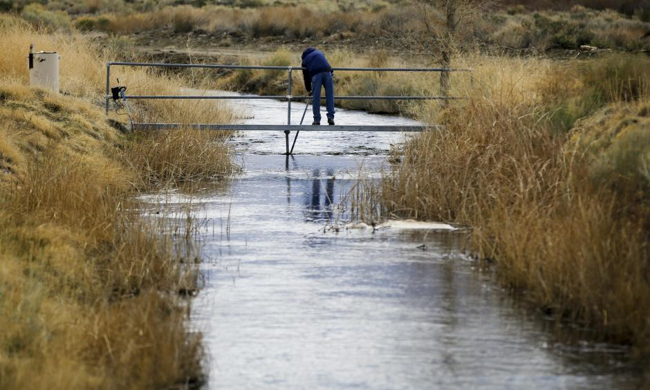 A DWP employee takes water readings March 25 on a tributary of the Owens River near Bishop. With a season of record snowfall in the Sierras, the Owens Valley is preparing for possible floods when everything starts melting. Photo: Mark Boster, LA Times