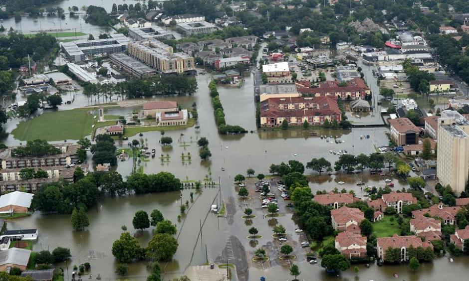 This aerial image shows flooded areas on and near the campus of Louisiana State University (LSU), Saturday, Aug. 13, 2016, in Baton Rouge, La. Photo: Patrick Dennis / The Advocate via AP