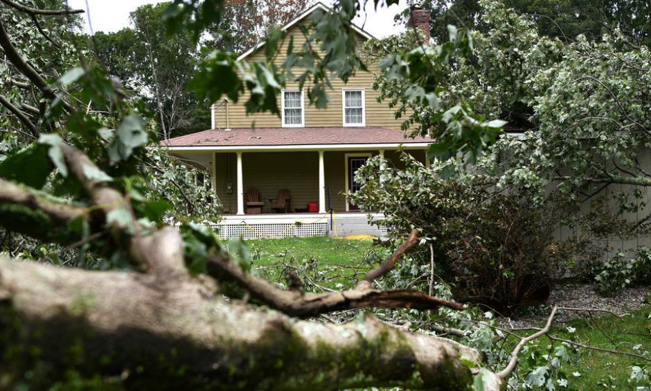 Debris cluttered Betty and Tom Therrien's yard after a tornado swept through the area near Douglas, Mass., last month. Photo: Christine Peterson, Worcester Telegram & Gazette via Associated Press