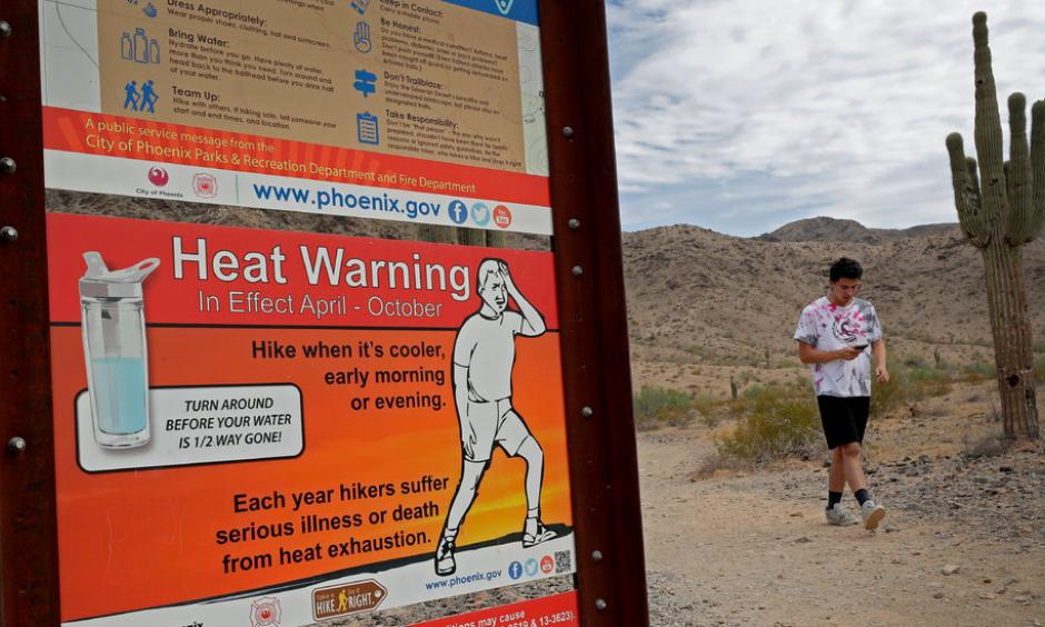 A morning walk at the South Mountain Preserve in Phoenix last month. Afternoon highs in Phoenix last summer averaged 106 degrees Fahrenheit, almost 3 degrees hotter than the average for the second half of the 20th century. Credit: Matt York, Associated Press