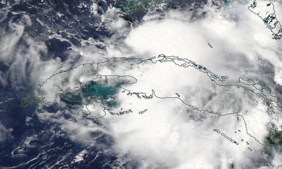 MODIS visible satellite image of Tropical Depression Nine (formerly 99L) forming in the Florida Straits on Sunday afternoon, August 28, 2016. Image: NASA