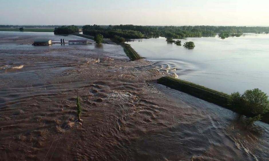 A breached levee on the Arkansas River, a common sight this spring. Photo: AP