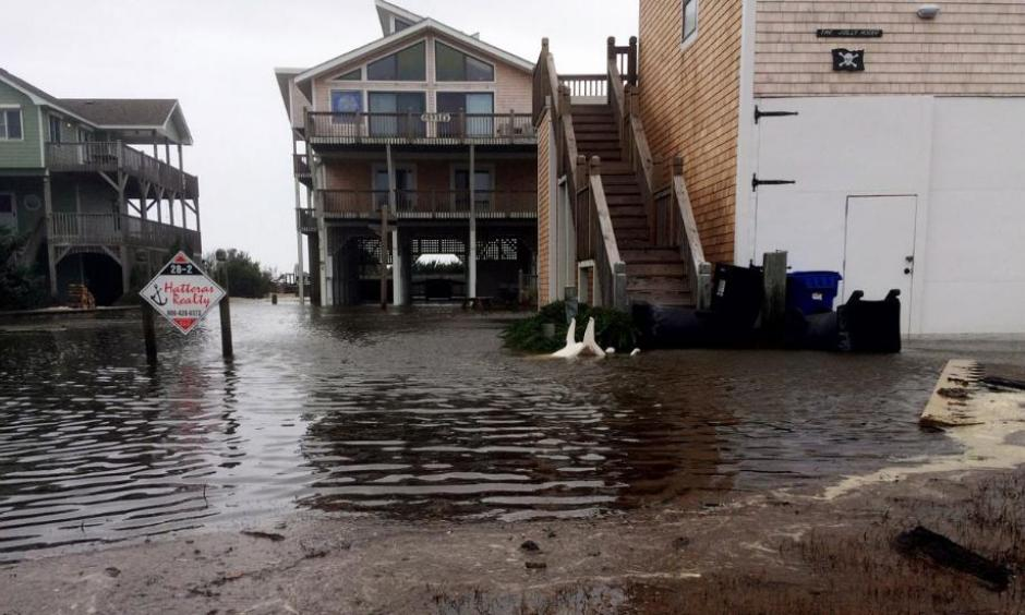 Floodwaters surround homes as Hurricane Maria moves closer to North Carolina's Outer Banks on Tuesday, Sept. 26, 2017. Thousands of visitors abandoned their vacation plans and left the area as the hurricane moved northward in the Atlantic, churning up surf and possible flooding. Photo: Ben Finley, AP