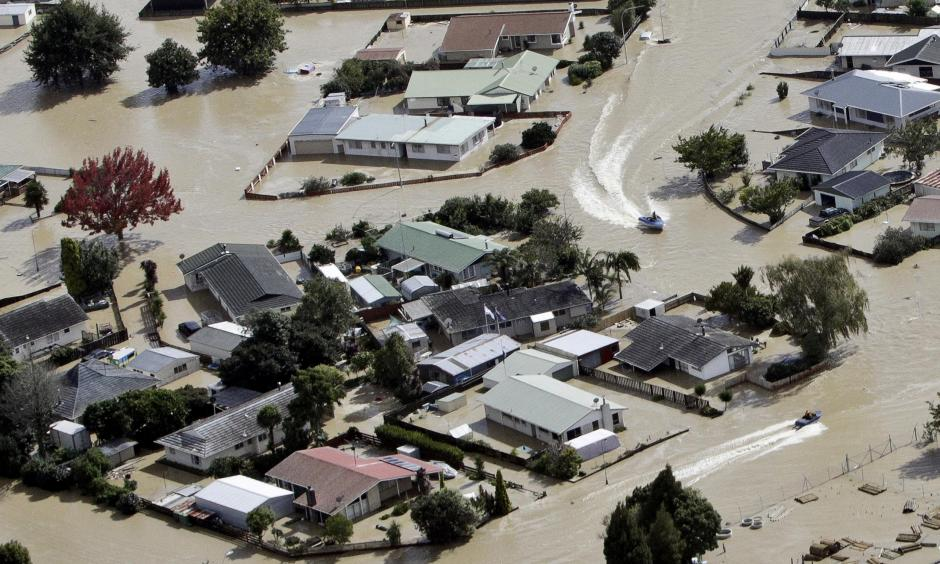 Jet boats drive through the flooded streets of the North Island town of Edgecumbe in New Zealand Andrew Warner/The Bay of Plenty Times/AP