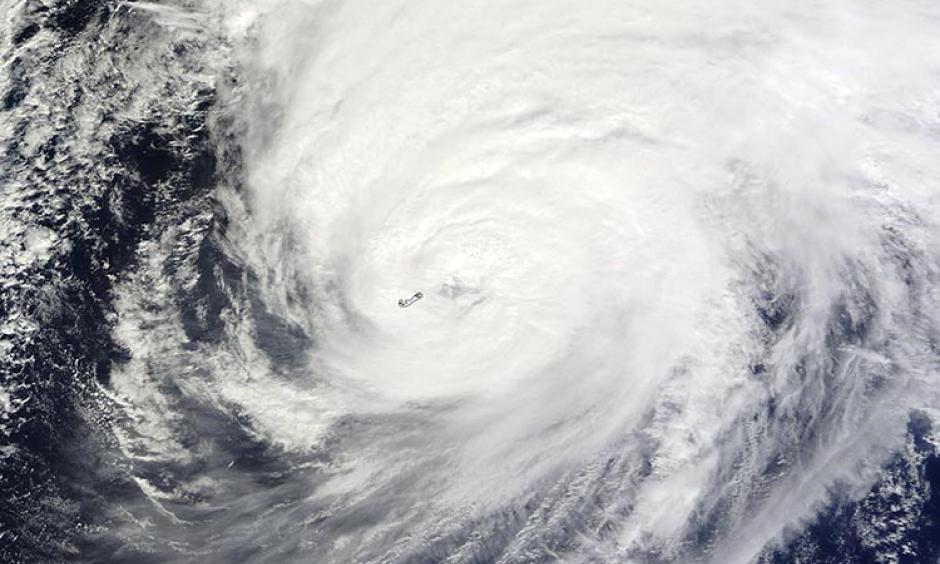 MODIS satellite image of Hurricane Nicole taken at 11:30 am EDT October 13, 2016. At the time, Nicole had just hit Bermuda as a Category 3 storm with 120 mph winds. Image: NASA