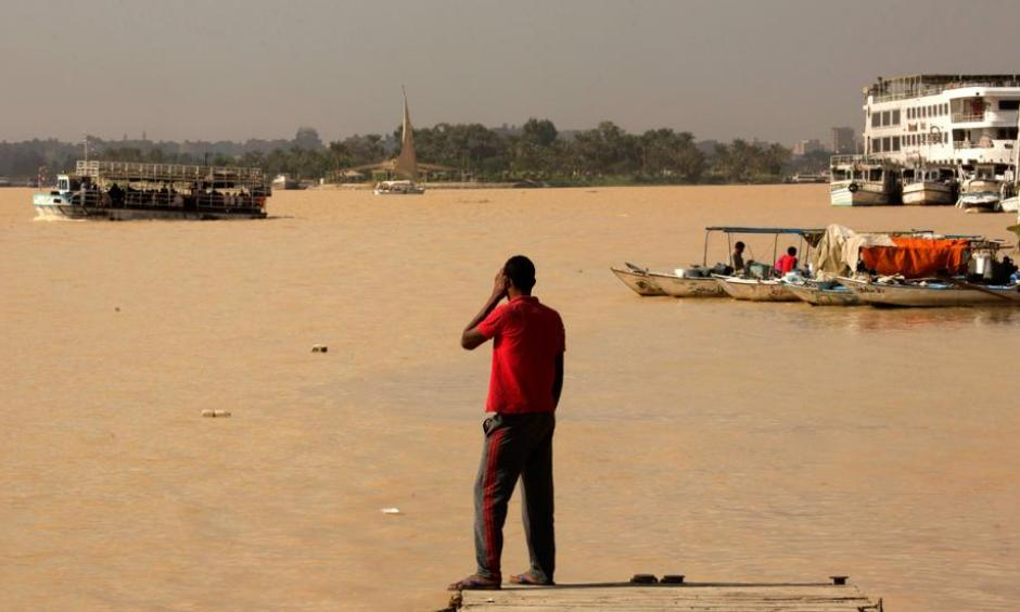 An Egyptian fisherman stands watching the Nile River as water appears a murky brown color due to the flooding in southern provinces, Beni Suef and Sohag south of the capital, in Cairo, Egypt, Tuesday, Nov. 1, 2016. Photo: Amr Nabil, AP