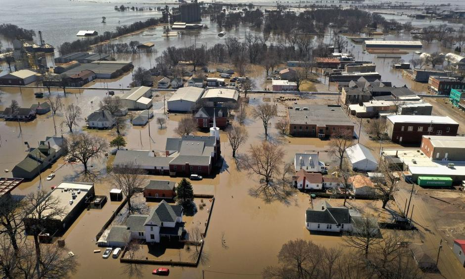 "Homes and businesses are surrounded by floodwater in Hamburg, Iowa. Several Midwest states are battling some of the worst flooding they have experienced in decades as rain and snow melt from the recent ""bomb cyclone"" has inundated rivers and streams. Photo: Scott Olson, Getty Images"