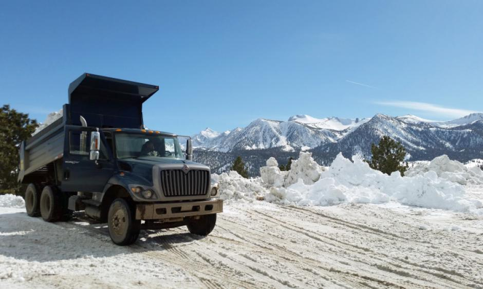 This March 2, 2017 photo provided by the California National Guard shows a Guard dump truck helping to clear huge snow drifts from the Eastern Sierra town of Mammoth Lakes, Calif. Photo: California National Guard via AP