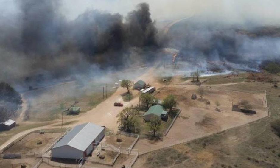 The Anderson Creek Fire threatening ranch buildings in Woods County, Okla., on Thursday. The fire has burned nearly 400,000 acres in two states. Photo: Oklahoma Forestry Services