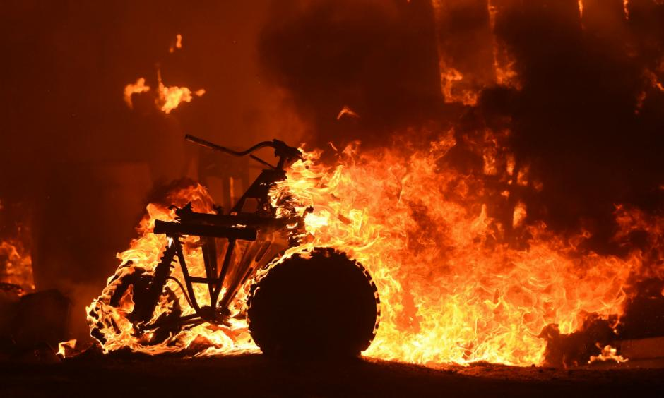 An early July heat wave dried out scrub and underbrush, fueling wildfires across California and the West that destroyed homes and forced thousands of people to evacuate. Photo: Josh Edelson, AFP/Getty