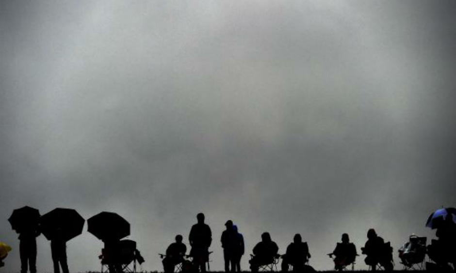 Spectators brave the rain to watch the qualifying session ahead of the the U.S. Formula One Grand Prix at the Circuit of the Americas in Austin, Texas, on Oct. 25, 2015. Photo by Jewel Samad/AFP/Getty Images